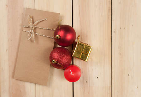 envelope: Envelope paper with candle and color ball on wood background,christmas holiday background