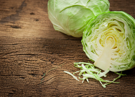 cabbage and cutted cabbage on wooden Stockfoto