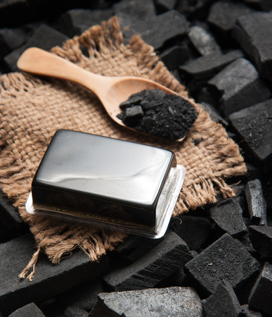 block of natural carbon soap and Black charcoal texture background
