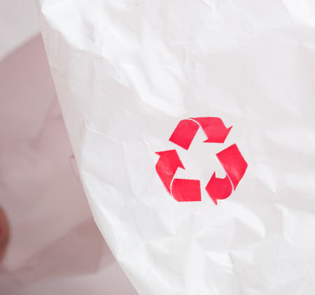 logo recyclage: Recycling logo on white plastic recycled