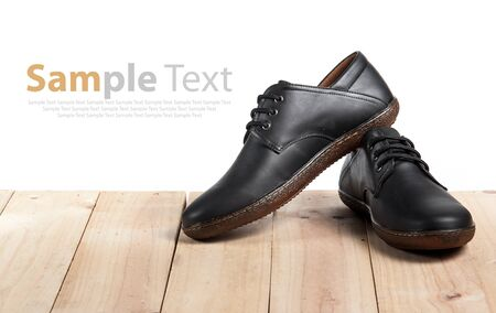 accessories horse: Mens leather shoes on wood Stock Photo