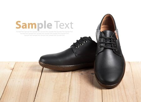 brogues: Mens leather shoes on wood Stock Photo