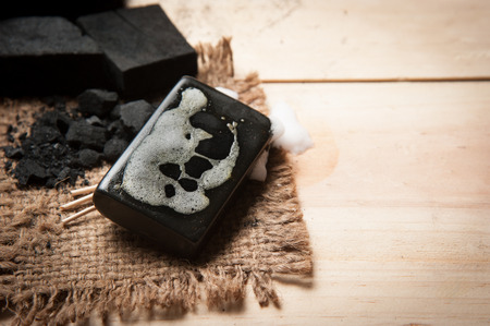 block of natural carbon soap and Black charcoal Stockfoto