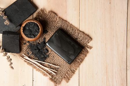 block of natural carbon soap and Black charcoal Standard-Bild