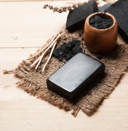 block of natural carbon soap and Black charcoal Foto de archivo