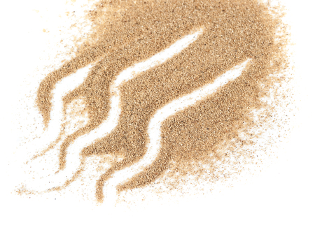 cadre: closeup of a pile of sand on a white background Stock Photo