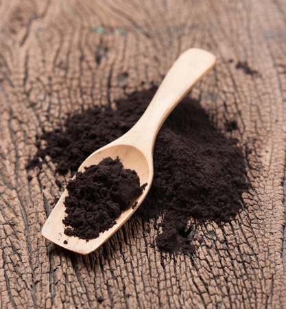 black powder: close up of a spoon and black powder on wood Stock Photo