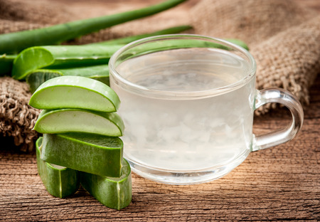 Aloe Vera Healthy drink on wooden background