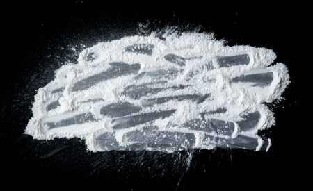 talcum: Talcum Powder on a black slate Stock Photo