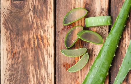 Aloe vera sliced on wooden background