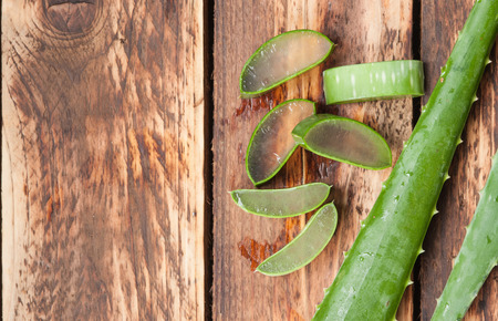 aloe vera: Aloe vera sliced on wooden background