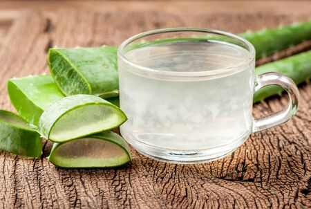 radicals: Aloe Vera Healthy drink on wooden background