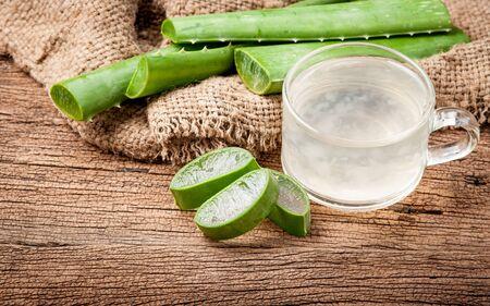 neutralize: Aloe Vera Healthy drink on wooden background