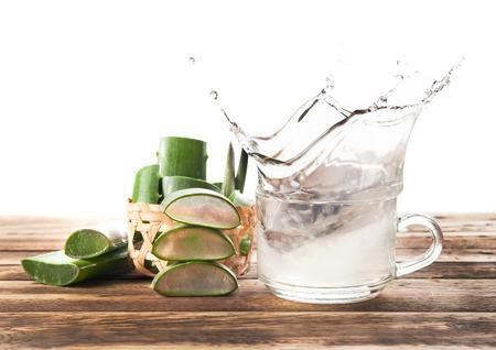 free radicals: Splash of Aloe Vera Healthy drink on wooden background