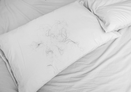white hair: Hair loss with Pillow on the bed, background