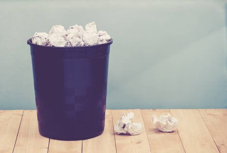 discard: Recycle,trash bin and crumpled paper balls on wood ; vintage tone style