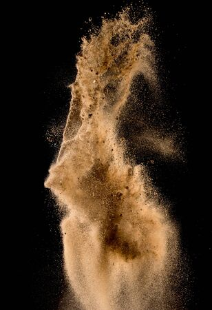 desert sand: Sandy explosion isolated on over dark background,Abstract sand cloud,Motion blur