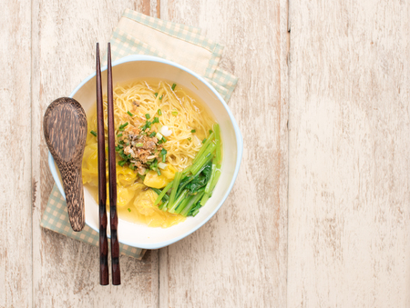 tabel: Egg noodle soup on tabel wood Stock Photo