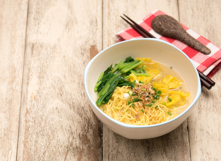 tabel: Egg noodle soup on tabel wood Stock Photo
