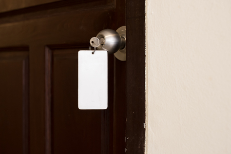doorkey: house key with hotel card and hotel door Stock Photo