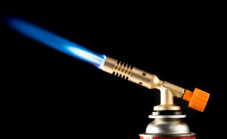 青い炎と手動ガス バーナー 写真素材
