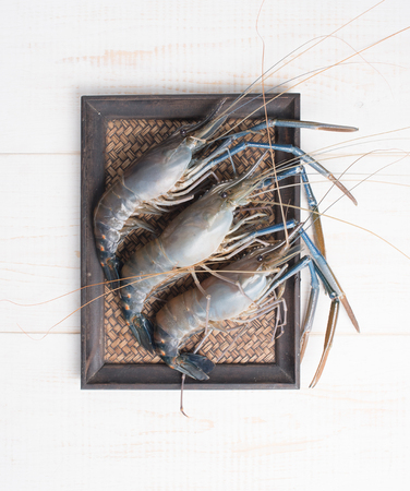 Giant river prawn on wood , top view
