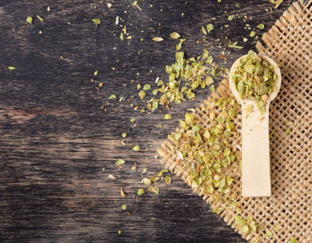 Dried marjoram spice on wood background,Origanum majorana