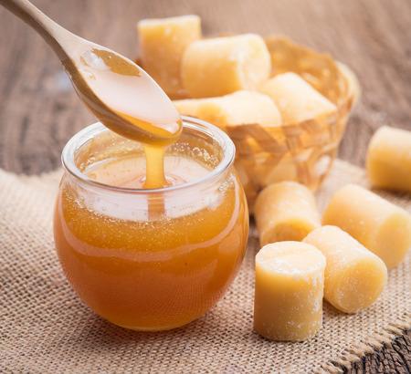 sugar palm: Coconut sugar and sugar syrup in glass bowl on wood