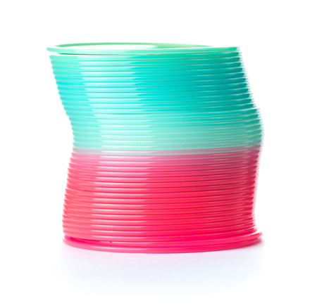 Slinky spring toy isolated on white. Red and blue spring toy.