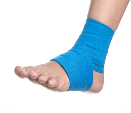 Ankle wrapped in elastic bandage on white background,Ankle pain Stock Photo
