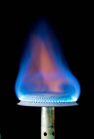 Fire from gas kitchen stove on a black background,Burning blue gas. Stock Photo