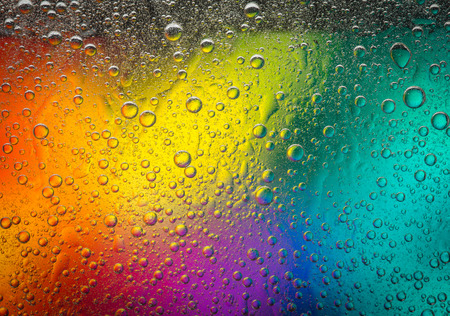 complementary: Complementary colors oil drops and water drops on glass,abstract background Stock Photo