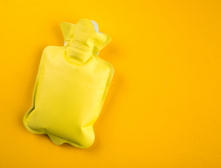 wärmflasche: Yellow hot water bottle with Text Space,top view