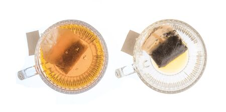 Top view of a cup of tea with tea bag isolated on white background
