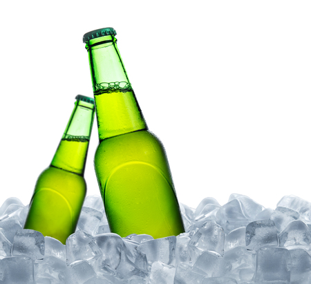 Cold bottle of beer with drops in ice cubes isolated on a white Stock fotó