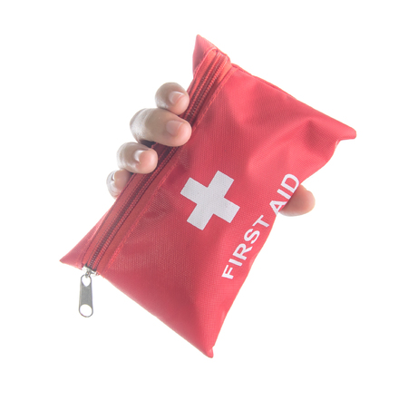 Hand holding First aid medical kit isolated on white background,Front view Publikacyjne