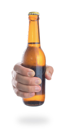 cold cut: Beer bottle in the hand isolated on white background,Front view