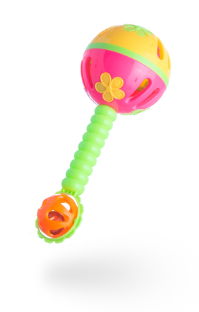 childrens plastic toy bell on white background Stock Photo