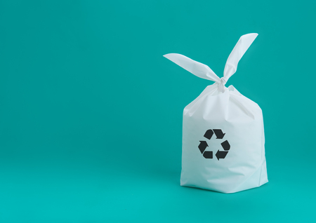 White plastic bag with recycle sign on green mint background,Recycle Concept Stock Photo