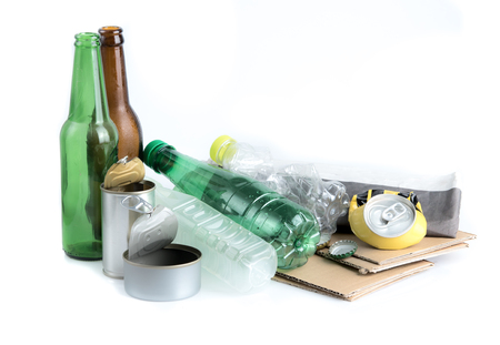 Recyclable garbage consisting of glass, plastic bottle, metal and paper isolated on white background Stock Photo