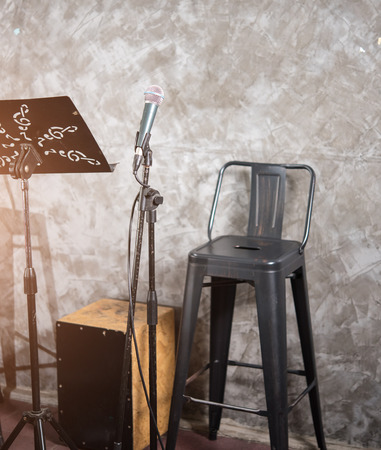 Microphone with chair on stage show