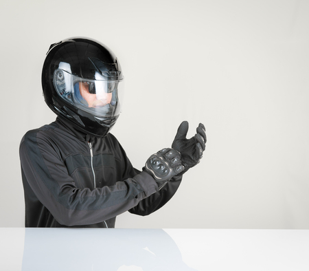 Biker with helmet on gray background,Text Space