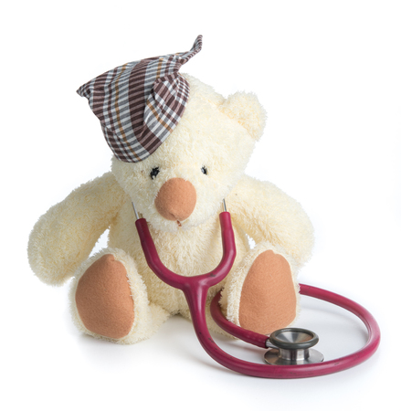 teddy bear using a stethoscope on a white background Stock Photo