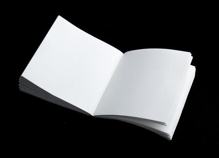 Open blank note book on black background Standard-Bild