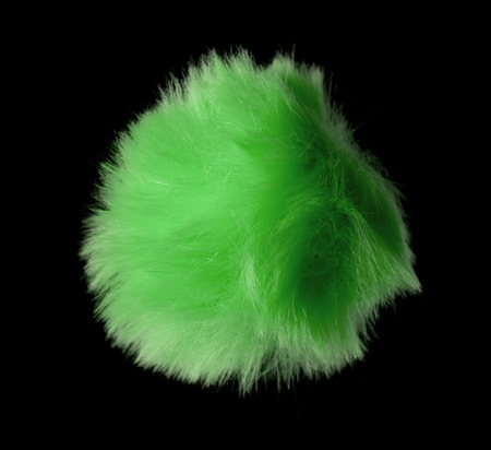 Abstract green fur ball isolated on black background