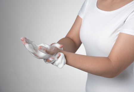 Soapy foam,washing hands on gray background