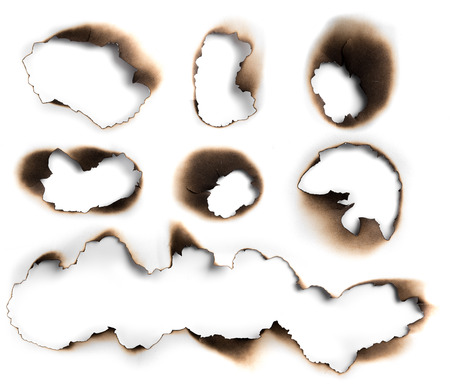 White paper burn hole with shadow on white background