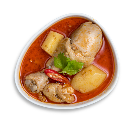 Spicy Muslim chicken curry,Thai massaman curry in a bowl isolated on white background Stock Photo