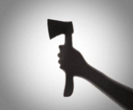 Silhouette of someone holding axe,blur image 版權商用圖片