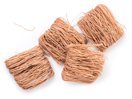 Raw brown rice vermicelli on white background Banque d'images